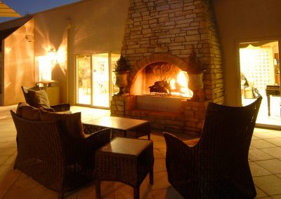 Beautiful outdoor fireplace at night