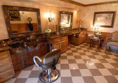 Elegant resident salon with clean floors and granite countertops