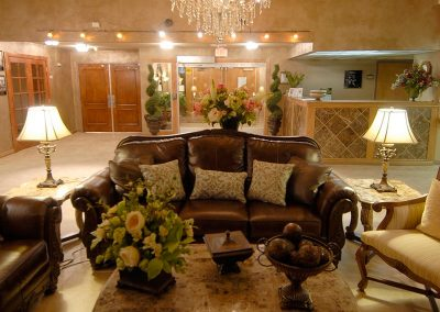 Beautiful lobby with oversized leather couches and a beautiful chandelier overhead