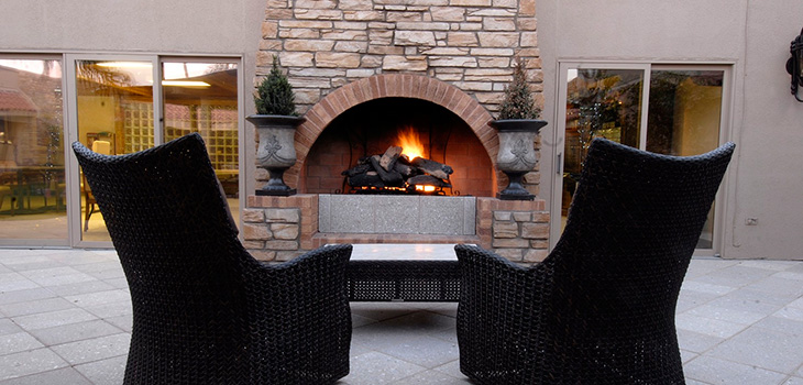 Outside seating next to a large fireplace