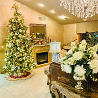 Beautifully decorated lobby and holiday tree sparkling by the fireplace