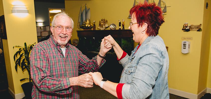 Sonoma Hills Retirement Community resident and staff member enjoying an activity .