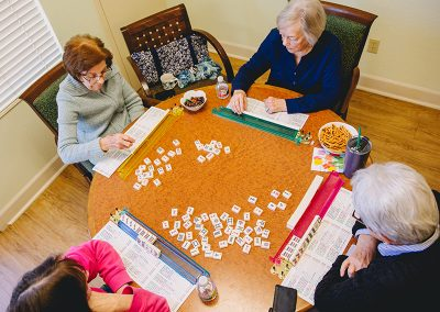 Residents playing a table game together