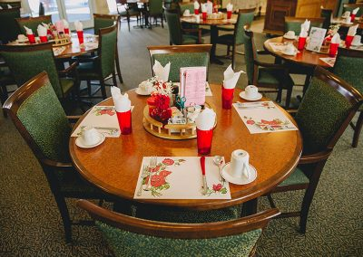 Resident dining room with place settings eagerly awaiting the residents