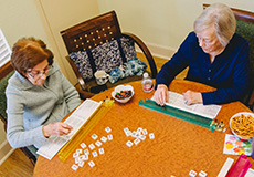 Residents playing a table top game together