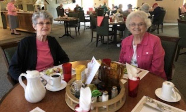 Two ladies eating together.