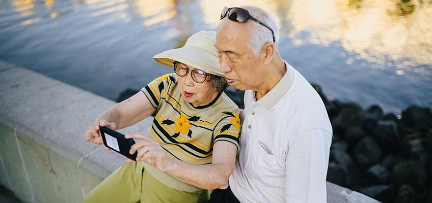 Elderly couple taking a selfie