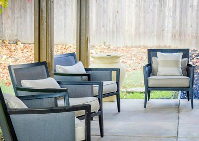Comfortable outside seating under a sturdy patio cover