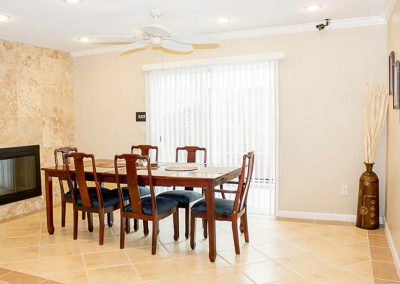 Resident dining area with beautiful tile floors and a fireplace
