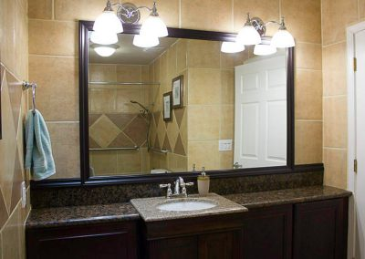 Beautiful upgraded bathroom with granite counter tops and tiled walls