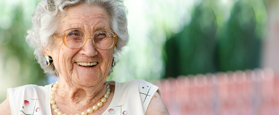 Elderly woman outside smiling
