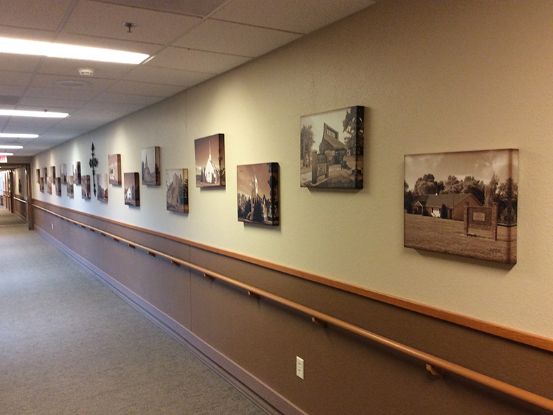 Hallway with images on the wall and a cross