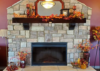Stone fireplace beautifully decorated for the harvest season