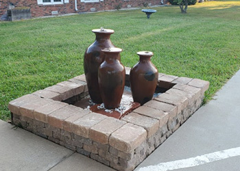 fountain on the property that provide a soothing background noise for residents