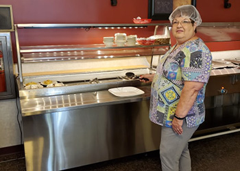 Chef restocking the buffet table at Lakeside Suites Assisted Living