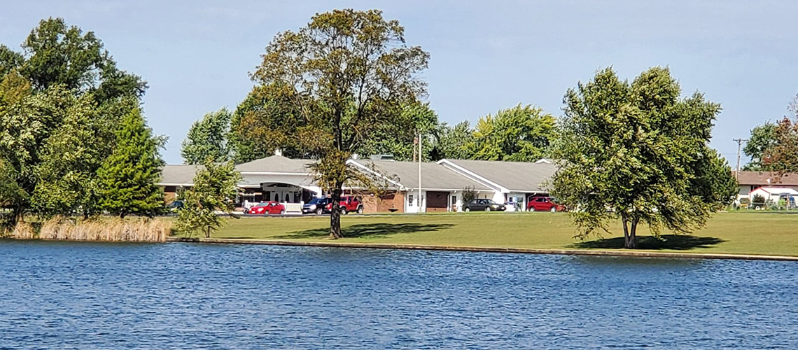 View across the lake of Lincoln Community Care Center