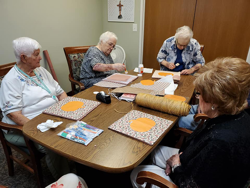 """Working on """"Fall"""" crafts and waiting for a turn with the paint brushes"""