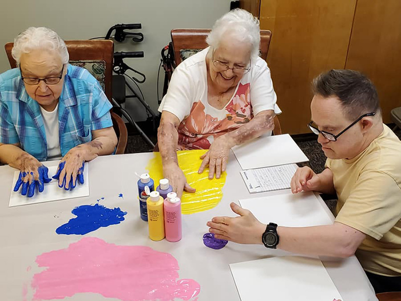 Making hand prints with finger paints