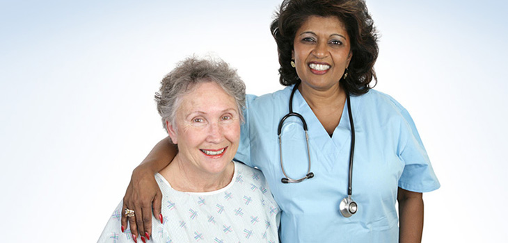 Nurse with her arm around a resident, both are smiling
