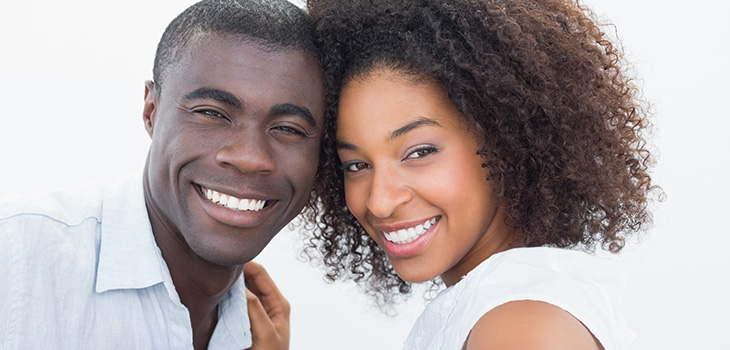 Couple with big smiles leaning their heads together