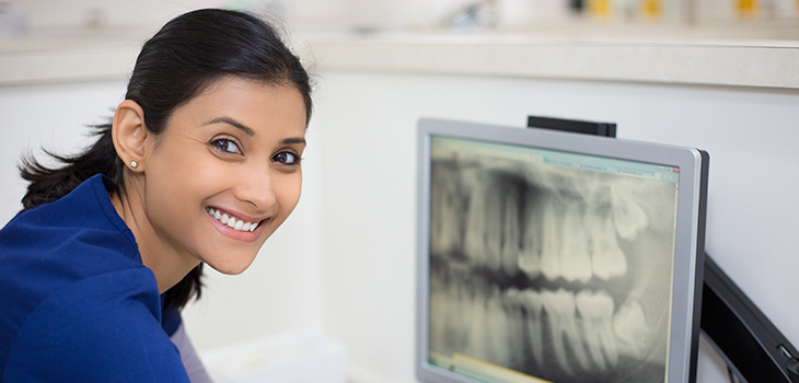 Doctor looking at x-rays of teeth