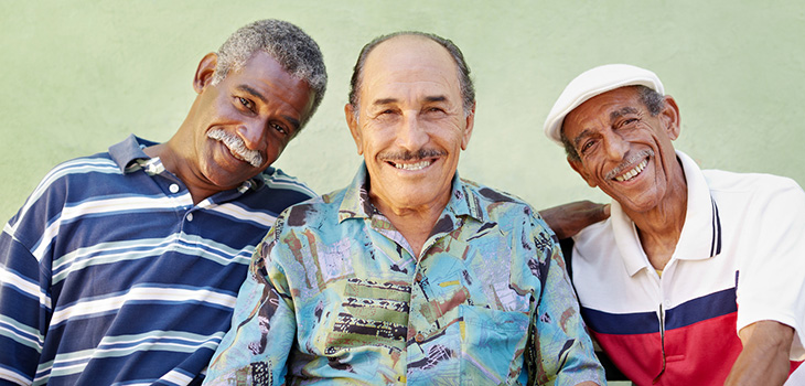 Three men smiling together