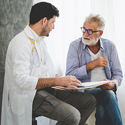 elderly man consulting with a doctor