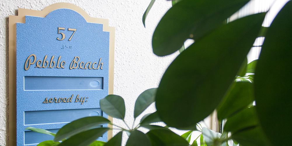 sign on the door of pebble beach room