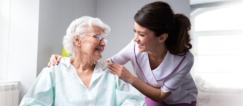 nurse tending to elderly patient