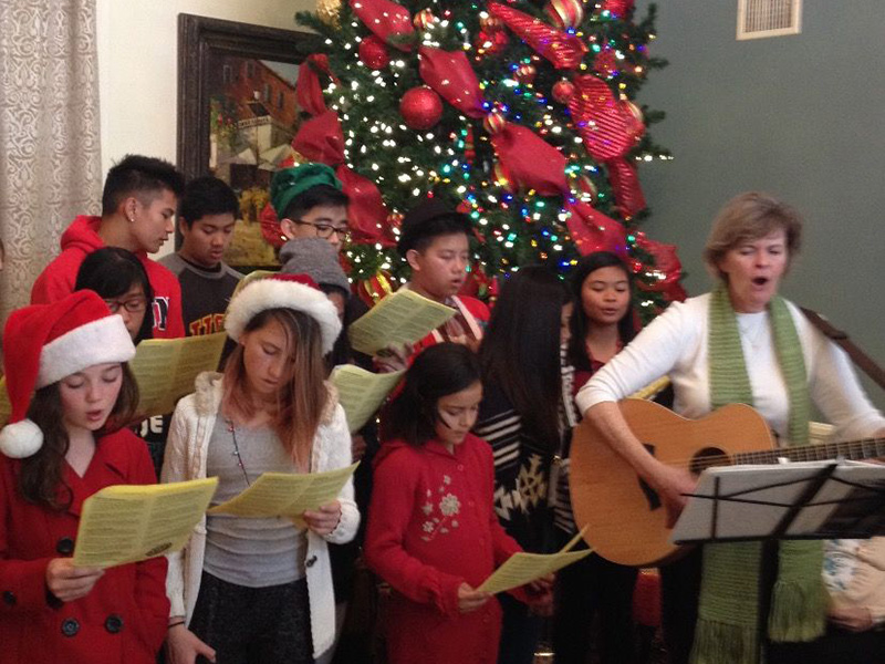 A group singing to residents for Christmas.