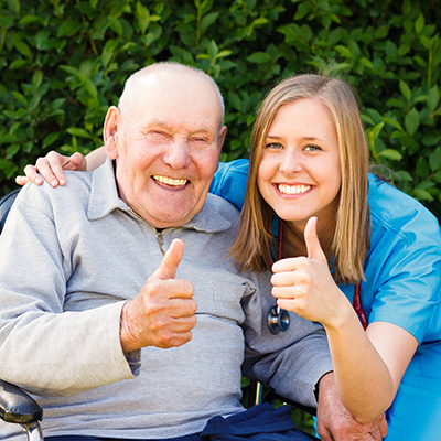 nurse and patient smiling with thumbs up