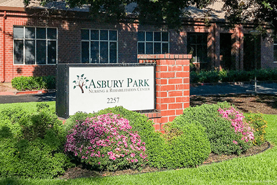Asbury Park sign in front of building