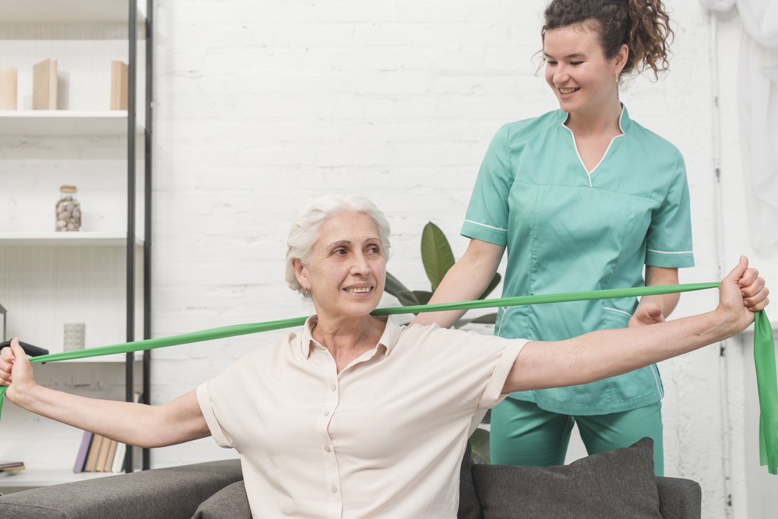 woman doing physical therapy with a nurse