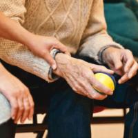 elderly man holding a ball