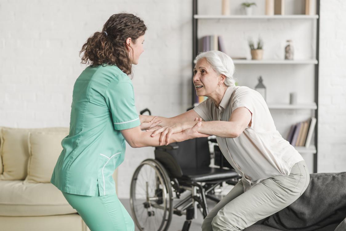 nurse helping woman in a wheelchair