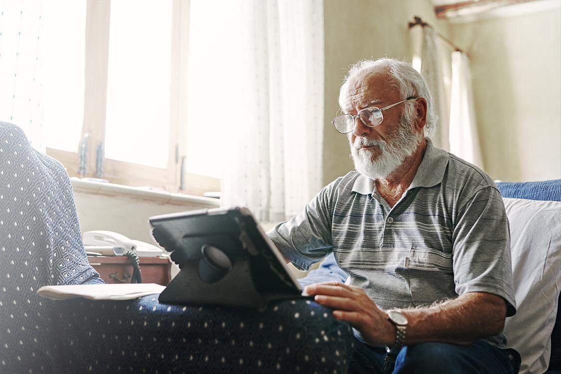 elderly man using an ipad