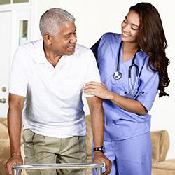 nurse helping man at therapy