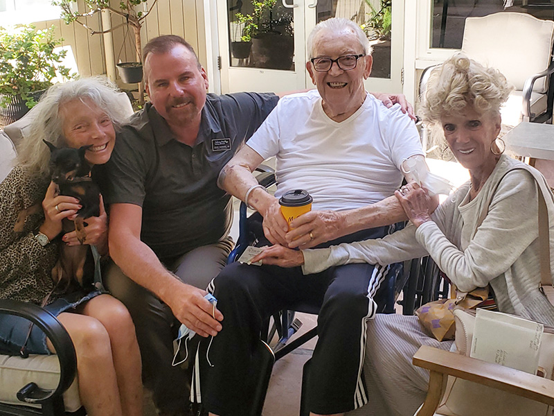 Doug Hawkins, RN visiting our resident and his beautiful family