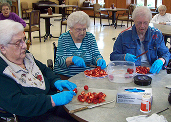 patients cutting strawberries