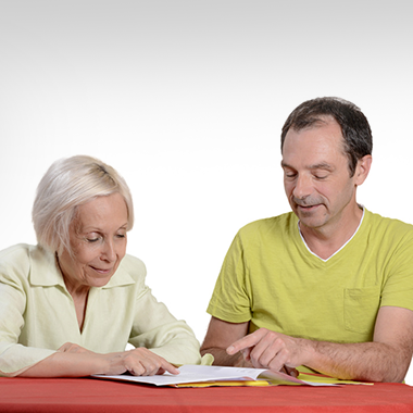 speech therapist and woman working on paperwork
