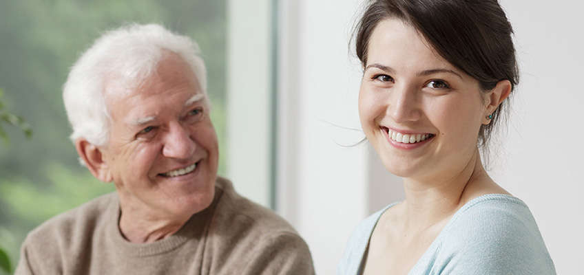 Therapist and resident smiling while doing speech therapy