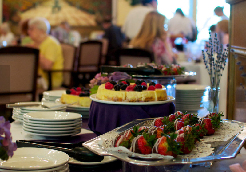 Traditional favorites and freshly baked desserts, chocolate-covered strawberries.