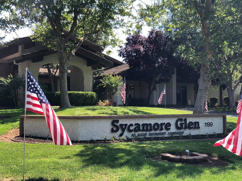 Front of Sycamore Glen building with United State flags