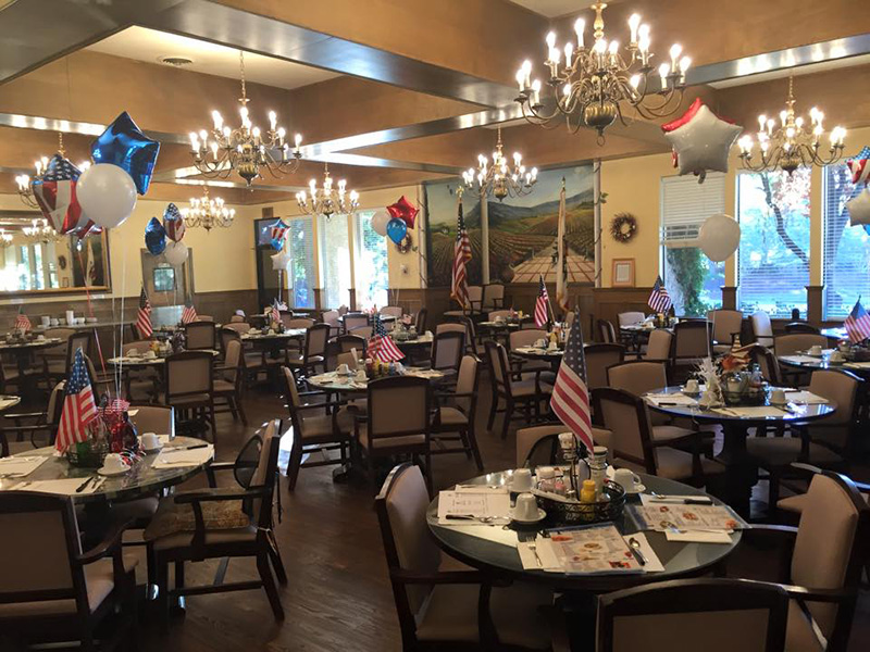 Dining Room decorated with patriotic themed balloons and United States flags