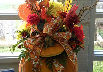 A pumpkin filled with flowers.
