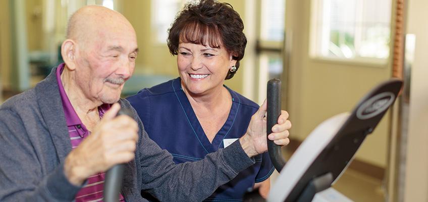 smiling elderly man exercising