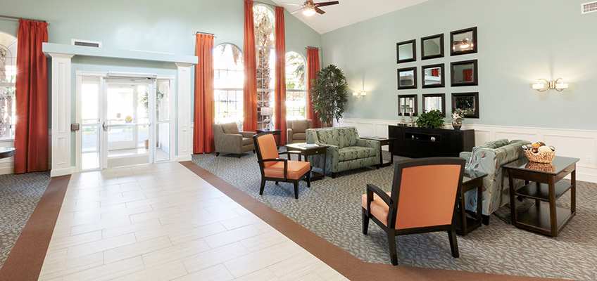 lobby area with white tiled walkway