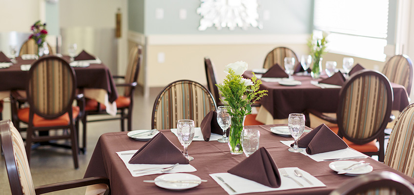 dining area with tables and table settings