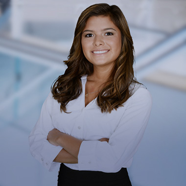 A business woman smiling with her arms folded