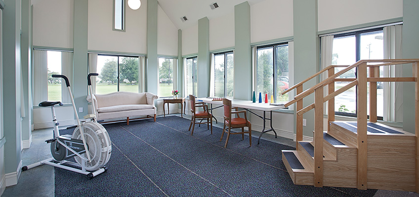 Manokin exercise room with lots of windows, light, and views of the outdoors